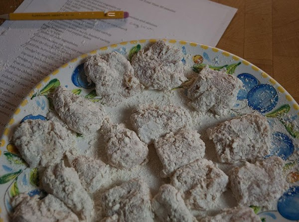 Dredge a second time in the flour/cayenne mixture, until thoroughly coated.