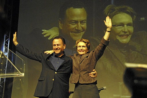 Party people: Helen Zille, with outgoing leader Tony Leon, thanks voters and supporters after being nominated the new leader of the DA in May 2007. Picture: ARNOLD PRONTO