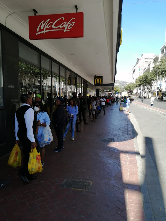 Shoppers in Cape Town on the first day of the nationwide lockdown.