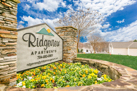 Property sign for Ridgeview surrounded by greenery