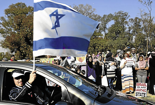 Targeted: South African Zionist Federation members rally in support of Israel in 2014 in Johannesburg. Cosatu international relations spokesman Bongani Masuku wrote about Jews who identify with Israel as if they support racism and fascism, the writer says. Picture: ALON SKUY