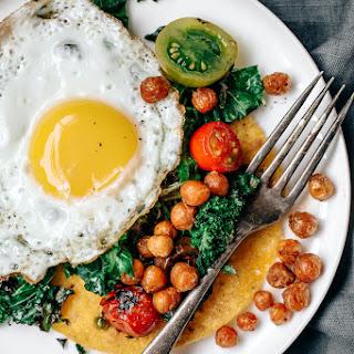Huevos Rancheros with Charred Kale, Tomatoes, and Crispy Garlic Chickpeas
