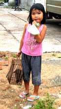 Photo: Year 2 Day 24 -  Little Girl with Rat in La Gi