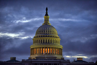 Photo: The US Capitol building is seen before sunrise on the morning after a bipartisan bill was passed by the House and the Senate to reopen the government and raise the debt limit, on October 17, 2013 in Washington, DC. US President Obama signed the bill into law, that will fund the government until January 15, 2014 and allow the government to pay bills until February 7, 2014. AFP Photo/Jewel Samad        (Photo credit should read JEWEL SAMAD/AFP/Getty Images)