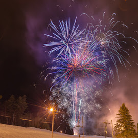 New Year's Fireworks At Cranmore Mountain by Chris Cavallo - Public Holidays New Year's Eve ( ski, mountain, snow, tree, winter, long exposure, fireworks, glow, lights, night photography, new year )