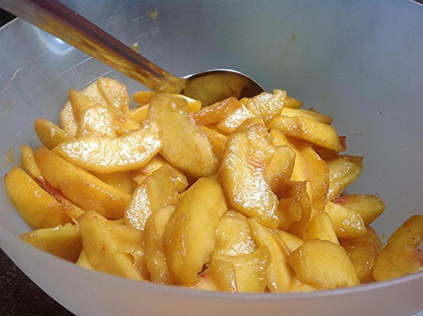 PREHEAT OVEN TO 375 DEGREES F. Peel and slice peaches into a large bowl....