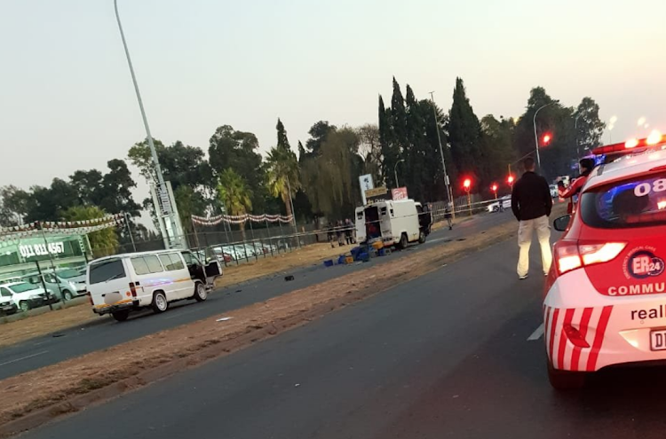 One person was killed and three injured in an apparent cash in transit heist.