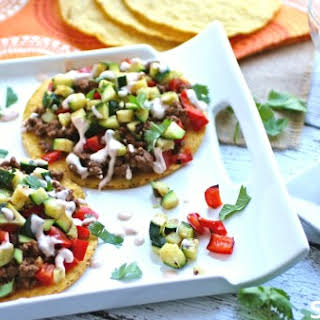 Beef And Zucchini Tostadas With Chipotle-cream Sauce.