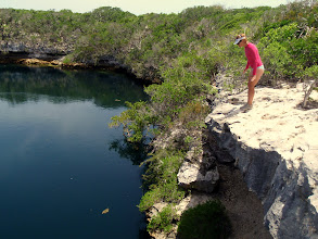 Photo: Anne sizing up the jump at Hoffman Cay Blue Hole