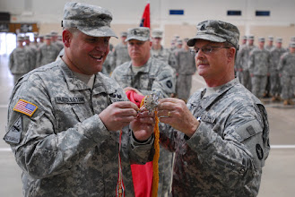 Photo: The Minnesota National Guard's 34th Combat Aviation Brigade, 34th Infantry Division earned an Iraq Campaign streamer for their OIF 08-10 deployment. The 34th CAB commander, COL Michael Huddleston attached the streamer with the assistance of retiring 34th CAB CSM Gery Thesing. Photo by Sgt. Nicholas Olson, 34CAB PAO