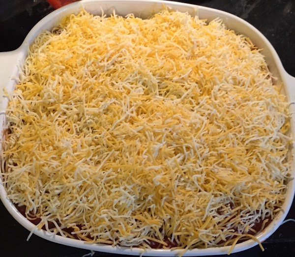 Spread salsa on top of chili,and top with shredded cheese.Bake in oven at 350...