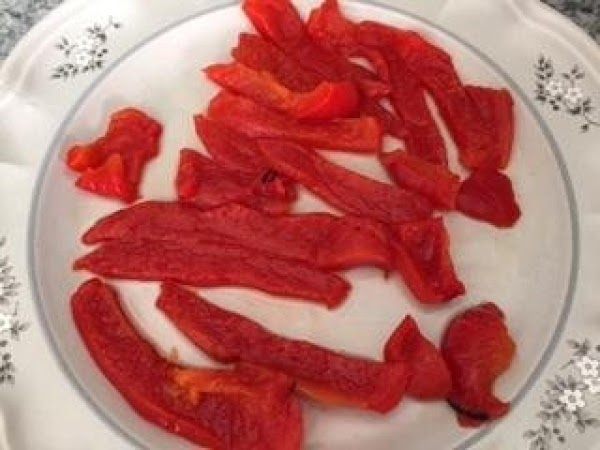 Slice up some of the flame roasted Italian Red Peppers.