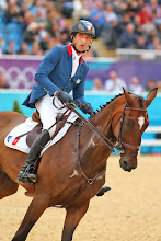 Photo: France's Olympic equestrian team blazers were designed by Hermes. The red-collared, blue blazers were designed in a technical fabric to allow riders freedom of movement. What do you think about this look?
