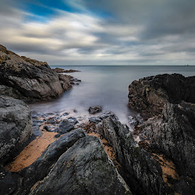 Colour of the ocean by Danny Charge - Landscapes Beaches ( sky, long exposure, water, rocky, filter, rock, sand, rocks, waterscape, nd, beach, skies, skyscape )