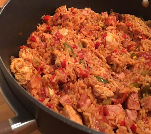 Rice With Chicken, Ham And Sausage In A Large Skillet.