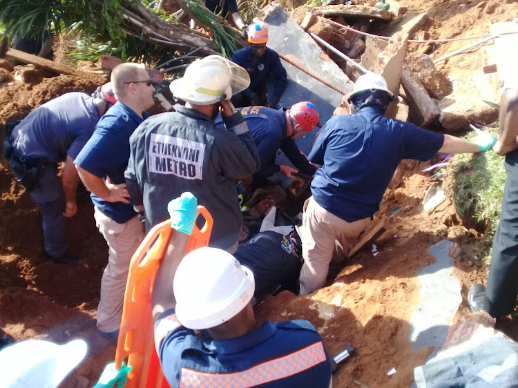 The construction worker was initially completely buried.