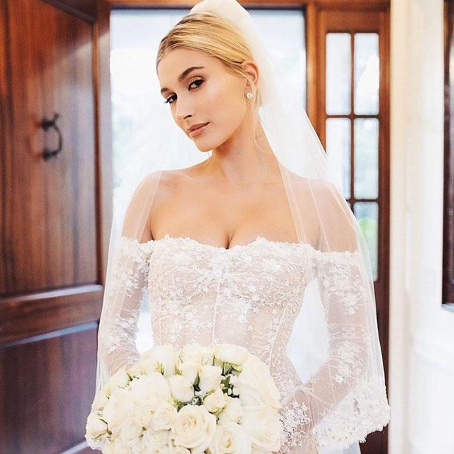A person in a wedding dress  Description automatically generated with medium confidence