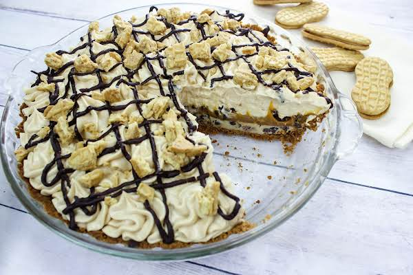 Chubby Hubby Peanut Butter Pie With A Slice Cut Out.