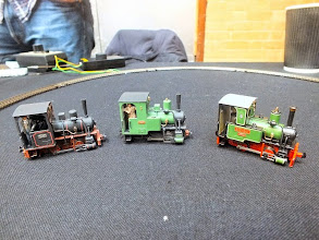 """Photo: 017 In the centre is an Orenstein & Koppel freelance 40hp loco body, released by Narrow Planet at ExpoNG, designed to fit on to the Minitrains Krauss 0-4-0 chassis, and flanking it are (left) an O&K 20hp loco and (right) Bredgar & Wormshill O&K """"Eigiau"""" by James Hilton and Tim Ellis respectively ."""