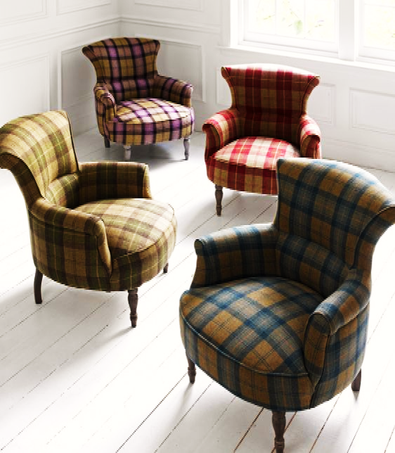 four chairs with plaid wool upholstery