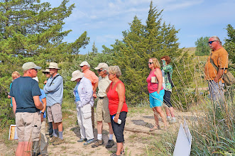 Photo: Paul explains the formation of the Sandhills. They are composed of sand eroded from the Rockies and blown east.