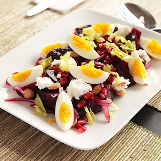 Roasted Beet Salad with Goat Cheese, Eggs, Pomegranate, and Marcona Almond Vinaigrette.