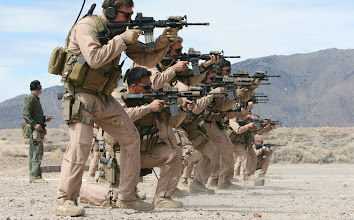Photo: Reno, Nev. - Marines and Sailors with a company from 2d Marine Special Operations Battalion, U.S. Marine Corps Forces, Special Operations Command sight in on their targets as they conduct shooting drills as part of their Dynamic Assault package at the Washoe County Regional Shooting Facility here, April 7.