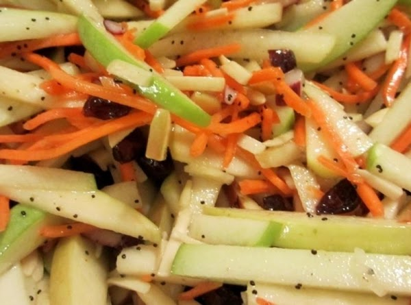 In a separate bowl, combine apple sticks, carrot sticks, and onion. Toss with the...