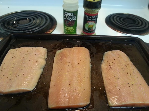 Sprinkle garlic powder and lemon pepper on both sides of salmon, place on baking...