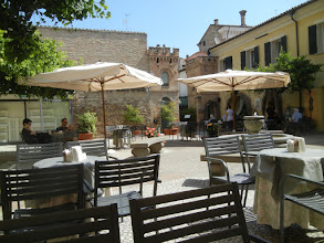 Photo: We found this caffe (Caffe Corte Cavour) on the way to see the famous stuff. It was a really pleasant place, comfortably shady on a hot day, with great coffee, and we stayed a while.