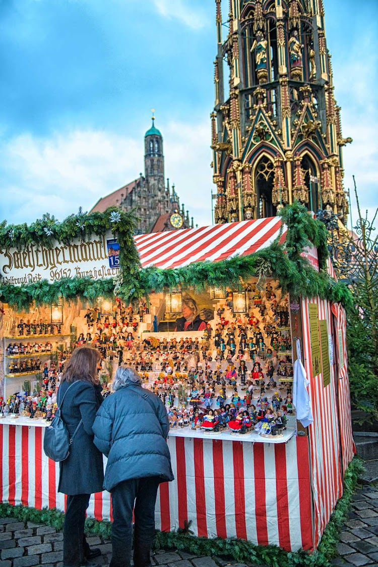 Take time to browse at the Nuremberg Christmas Market; this stall sells prune men, a traditional Nuremberg gift.
