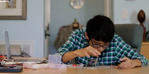Kenneth testing with a breadboard.