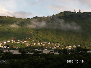 Photo: Low morning clouds, Manoa Valley.  These ones are probably 150m up, adjacent to the west wall.  They just met the rising sun and are starting to evaporate.  Half an hour later they were gone.
