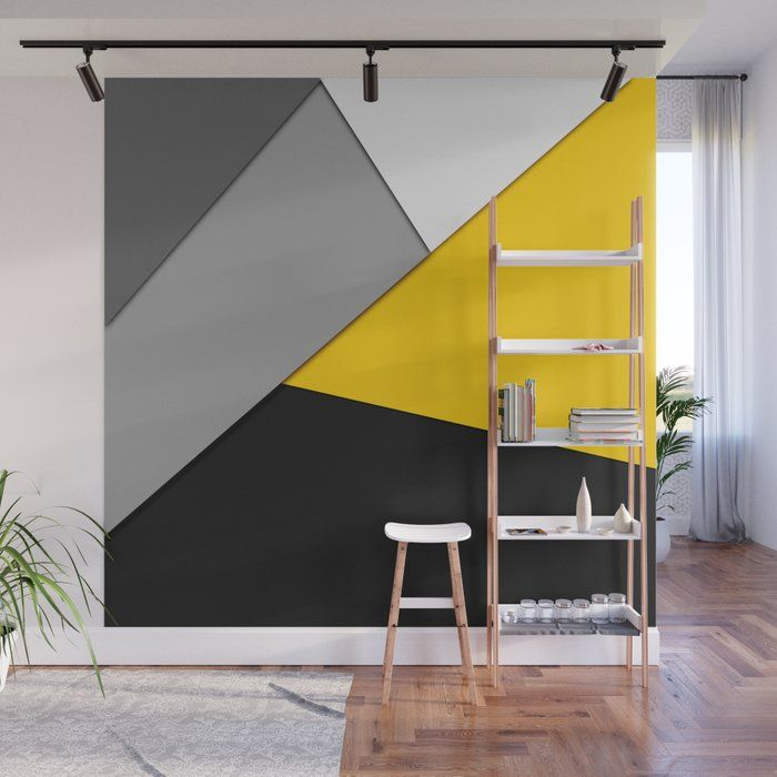 Using black, grey, white, and yellow paint colors to make a geometric accent wall.