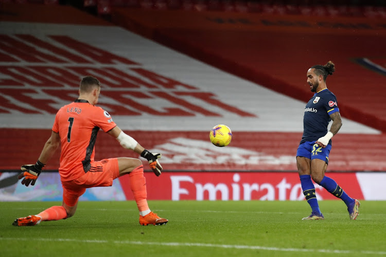 Theo Walcott of Southampton scores their team's first goal past Bernd Leno of Arsenal. Picture: PETER CZIBORRA/GETTY IMAGES