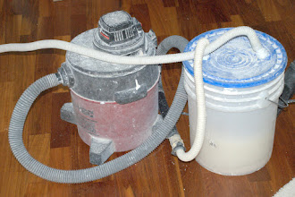 Photo: Vacuum (1½ HP) pulls air and dust through bucket half-filled with water, which filters out dust.