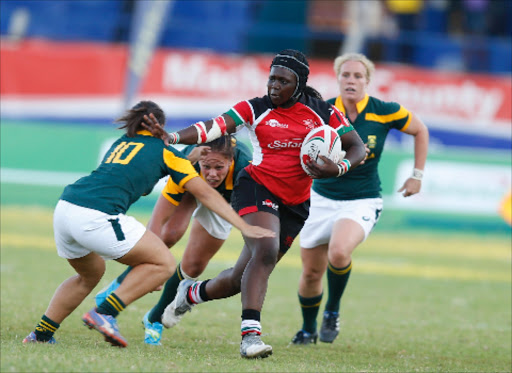 Kenya's Philadelphia Orlando palms off Mathrin Simmers of South Africa during a past international event