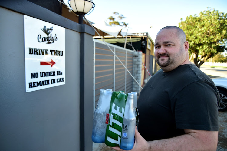 Candy's owner Charl Muller at the new entrance to the Heugh Road club which allows for liquor or coffee purchases on one side, and the special drive-through adult show and liquor delivery to customers' cars on the other