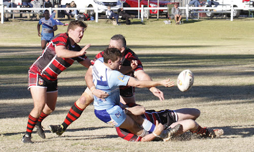 Blues hooker Jacob Nichols throws an offload close to the tryline. Nichols crossed for one try in Narrabri's close encounter with the Bears, as well as securing one Group Four best and fairest point.