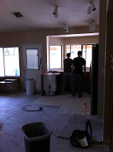Photo: BF and his brother remove the cabinets