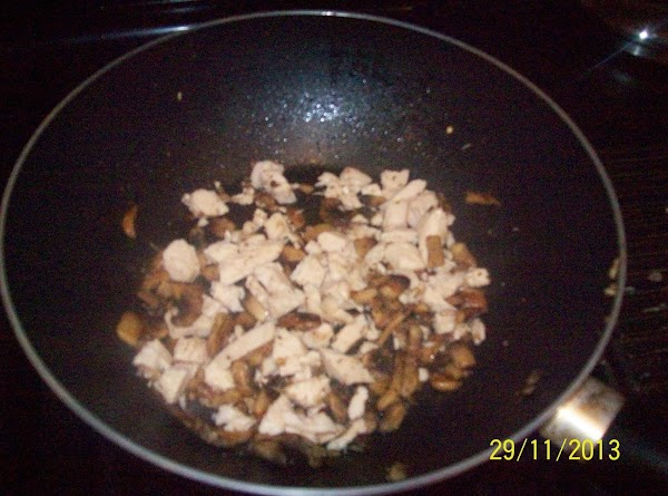 Add in the cooked chicken pieces to the mushrooms and wine mixture in the...