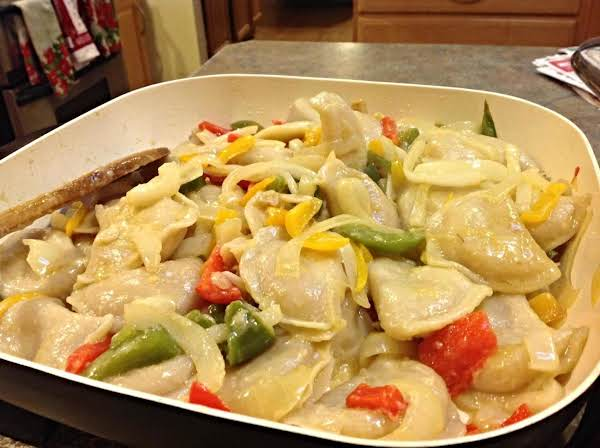 Cooking The Pierogie's With The Peppers And Onions In An Electric Skillet After They Have Been Boiled Helps To Make Dinner Quickly.
