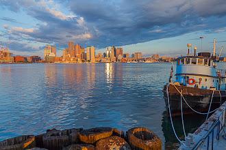 Photo: Boston Harbor and skyline with a blue tugboat, Boston, Massachusetts, USA