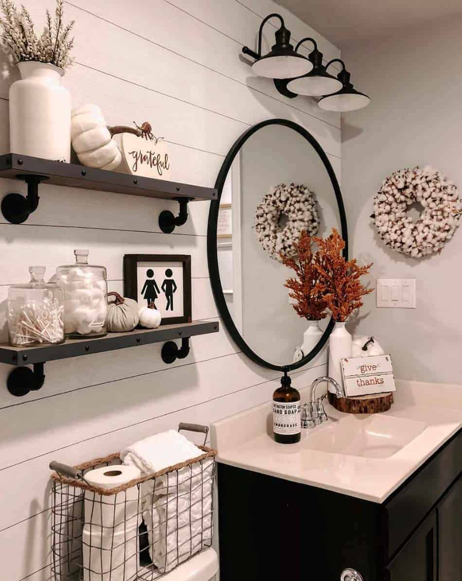 Bathroom with fall inspired accents, white pumpkins, grateful sign and a sign that reads give thanks, cotton wreath on the wall.