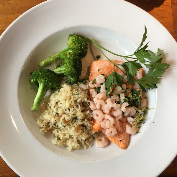 Wild salmon with Oregon cocktail shrimp, rice with raisins and almonds, and broccoli.