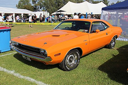 Stylish two door Dodge Challenger Coupe from 1970 with a protruding hood and aggressive angles.