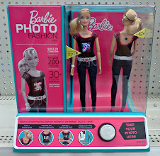 Photo: With 3 little girls a stop in the toy section can't be over looked. My daughters have wanted this Barbie Photo for years. You can see me on her screen!