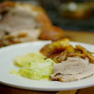 Slow Roast Shoulder Of Pork With Roasties And Apple Sauce With Hispi Cabbage.