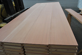 Photo: Unfinished stage of Sapele flooring, waiting for their 5 coats of poly-urethane. This flooring is both sound-deadening and insulated using our patented honeycomb sandwich panel design