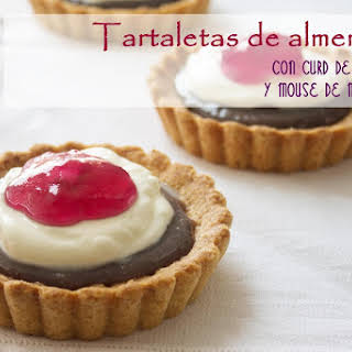 Almond Tartlets with Blueberry Curd and Mascarpone Mousse.
